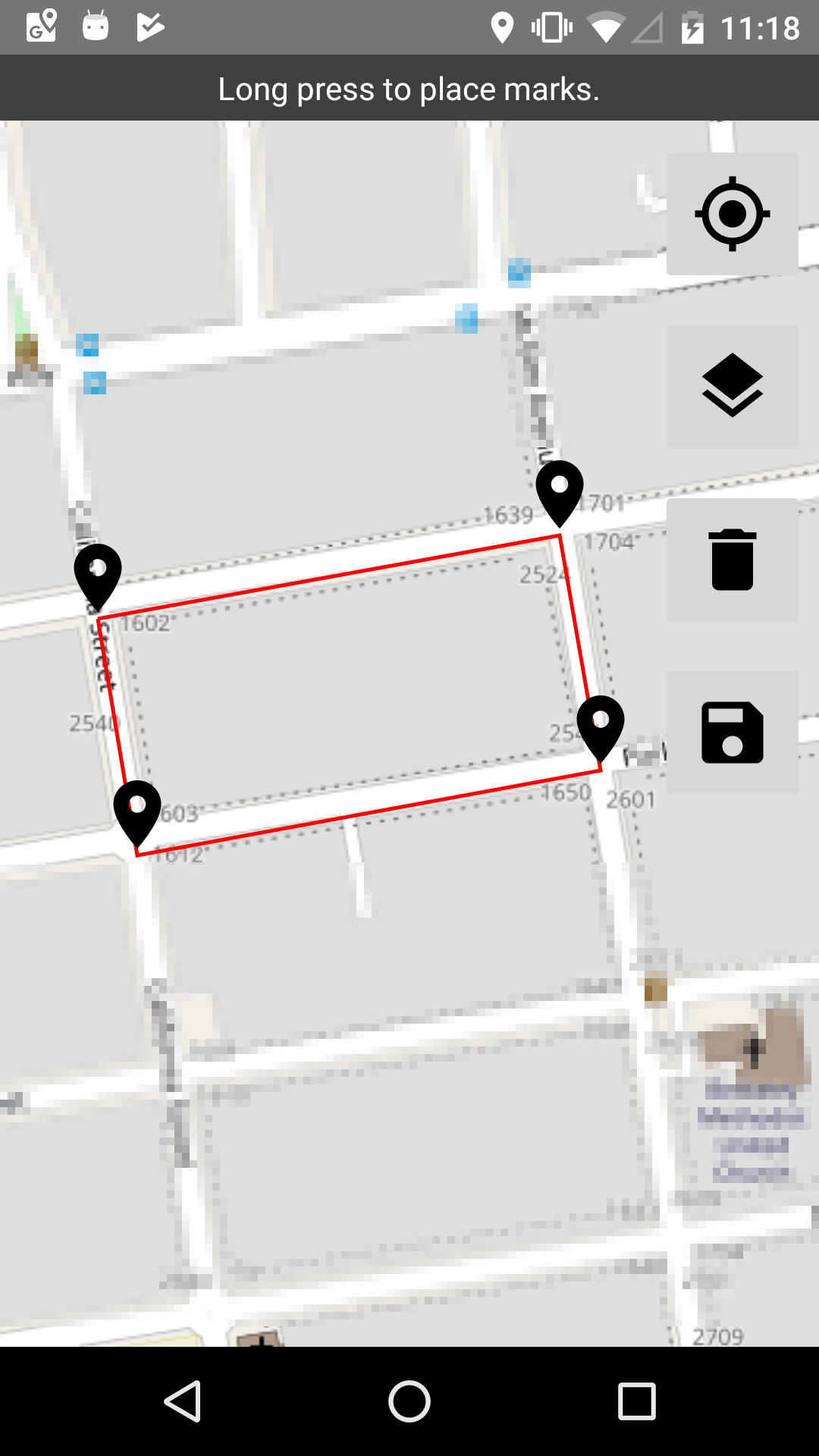 A map with four pins defining an area around a city block.