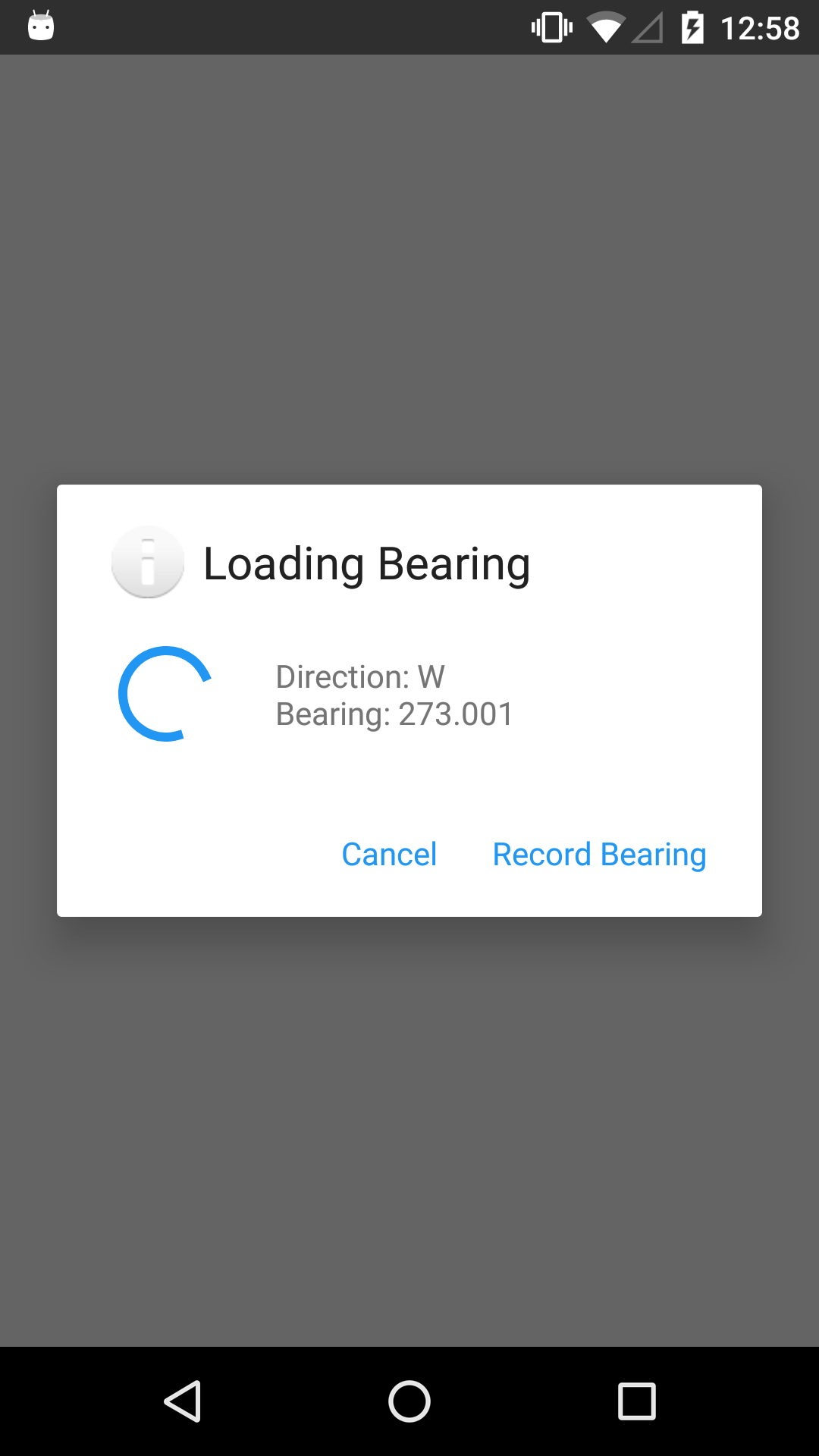 "The Bearing widget, overlaid with a model popup. The modal headline is ""Loading Bearing."" In the body of the modal are two fields: ""Direction: W"" and ""Bearing: 273.001"". At the bottom of the modal are Cancel and Record Bearing buttons."