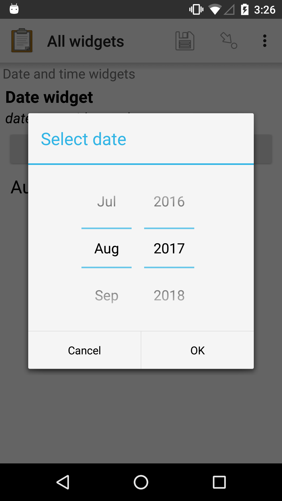 "The date widget, with a modal popup labeled ""Select date."" There are individual ""Spinner"" type selectors for month and year, but not for date. At the bottom are Cancel and OK buttons."