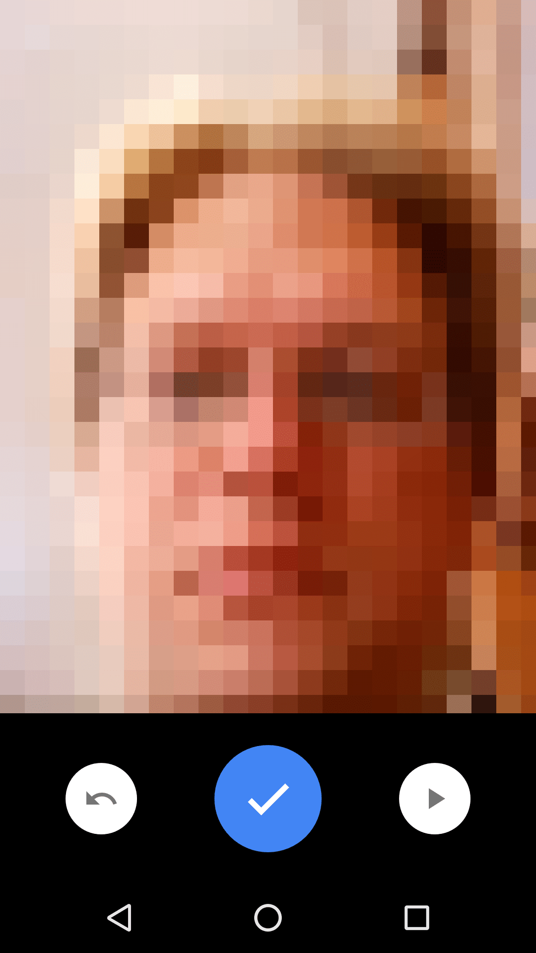 The Android camera app, in video mode. A person's face is in the camera viewer. Below the camera viewer is a large, blue checkmark button.
